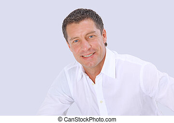 Closeup portrait of a senior man smiling on white background...
