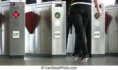 Going Through Skytrain Turnstile - People passing through...