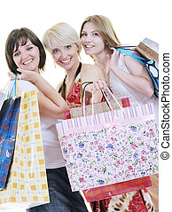 happy young adult women shopping with colored bags - women...