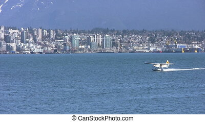 Float Plane Landing - A side shot of a float plane landing...