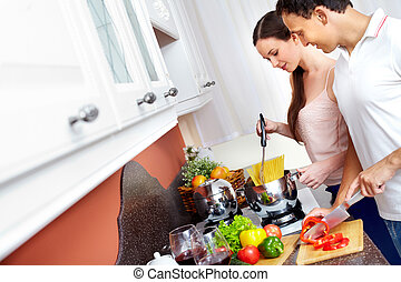 Cooking together - Portrait of amorous couple cooking...