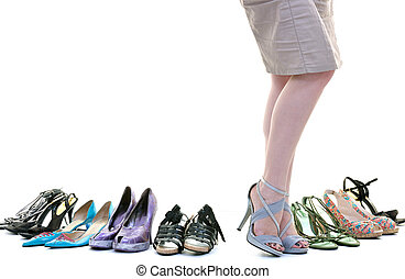 woman buy shoes concept of choice and shopping, isolated on white background in studio