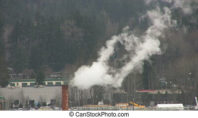 Factory Smoke - Smoke billowing out of a factory located...