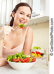 Healthy nutrition - Portrait of a girl eating salad and...