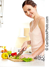 Cooking wife - Portrait of happy female cooking vegetable...