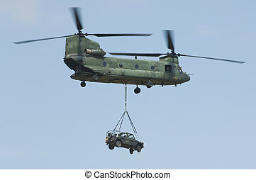CH-47 Chinook helicopter carrying 4x4x off-road mercedes