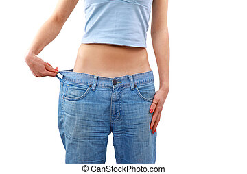 young woman in old jeans pant after losing weight
