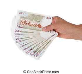 Hand holding Kenyan currency over white background