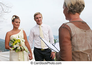 Bride and groom - Celebrant marrying a young couple
