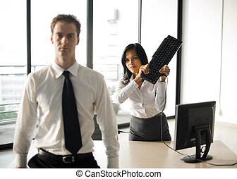 Frustrated Hate The Boss - A female office employee swings a...