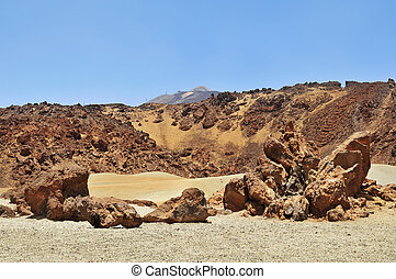 Volcanic landscape, with volcano Teide in the background, in Teide National Park, Tenerife, Canary Islands, Spain