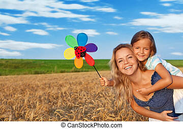 Woman and little girl having fun outdoors