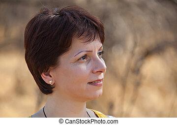 Mid age woman portrait, outdoor, people diversity