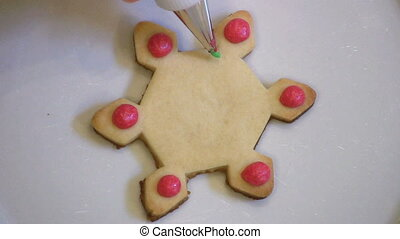 Decorating Christmas Snowflake Cook - A housewife decorates...