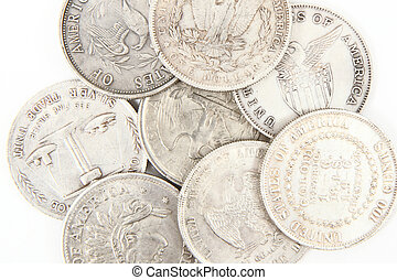 old silver dollars - old dollars isolated on the white...