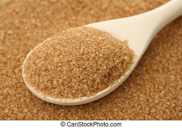 Cane sugar - Brown sugar in a wooden spoon