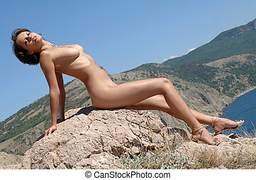 woman sitting on a rock - naked woman sitting on a rock