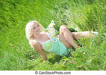 woman relaxing in the grass
