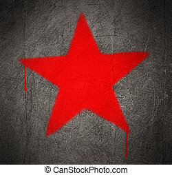 Communist red star graffiti on a grunge concrete wall