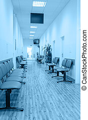 Interior of Hospital in Shades of Blue - Chairs in the...