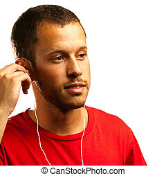 man listening to music with earphones on a white background