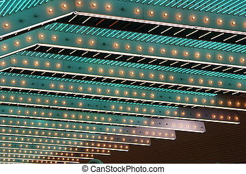 Neon - Green neon ceiling with several missing bulbs.