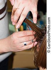 hairdresser cutting wet hair close-up, hair salon