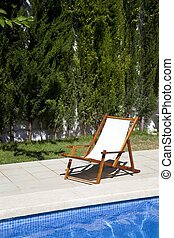 Deckchair in a swimming pool