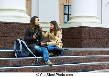 Young students on the steps