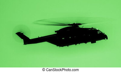 Helicopter in night vision - Merlin military helicopter...