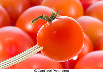 tomatoes with a fork in the foreground and background tomatoes