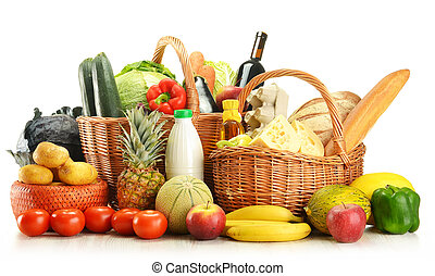 Groceries in wicker basket isolated