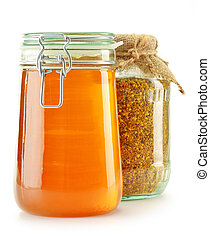 Jar with bee pollen and jar with honey isolated on white. Nutritional supplements