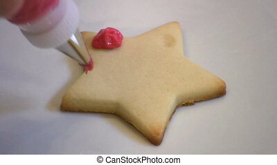 Decorating Christmas Cookie - A housewife decorates a pretty...