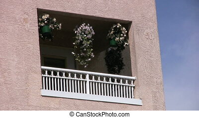 Hanging Flowers - A lovely shot of a balcony with colorful...