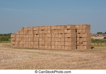 Haybale Stack - Photo of a stack of hay bales in summer