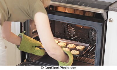 Cookies - Woman Wearing Oven Gloves Taking Fresh Baked...