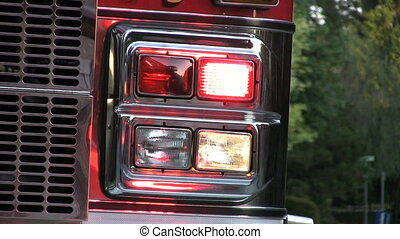 Lights On Firetruck With Traffic - Flashing lights on a...