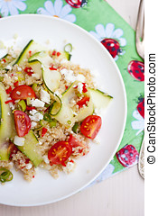 Healthy salad with quinoa, tomatoes and zucchini