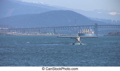 Float Plane Approaching Pier - A float plane approaches a...