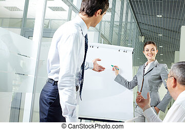 Discussion moment - Image of young woman explaining ideas on...
