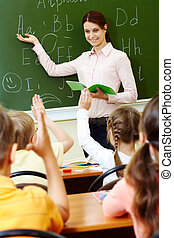 Explanation of teacher - Portrait of smart teacher pointing...