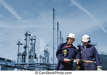engineering and technology - two engineers, workers with oil...
