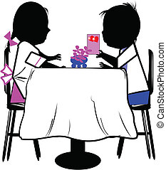 boy and girl at table - boy giving a valentines card to girl...