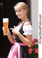 Young woman in dirndl with white be - Young Bavarian...