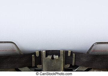 Typewriter with blank sheet