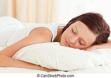 Close up of a gorgeous Woman sleeping in her bed