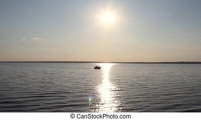 ship sailing into the sunrise.