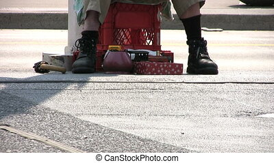Homeless Man Peddling Items - A shot of a homeless, down and...