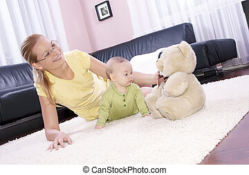 Beautiful mom with her son playing happily - Beautiful...